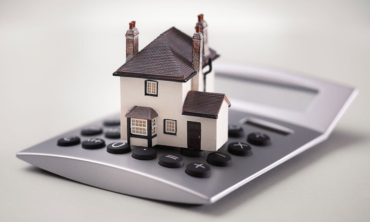 House on top of a calculator