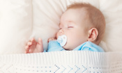 Is a cardboard baby box safe for a sleeping baby?