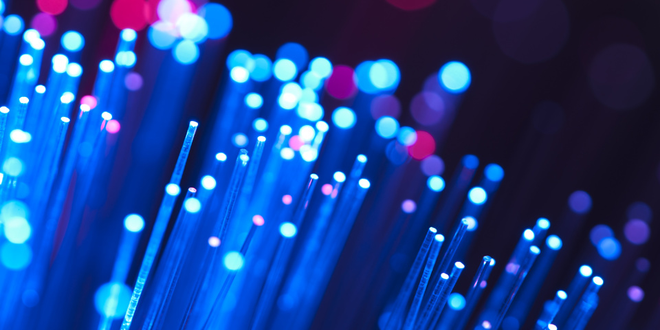 Blue and red fibre optical cables on a black background