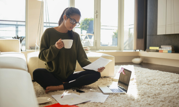 Young woman reading heating oil quotes