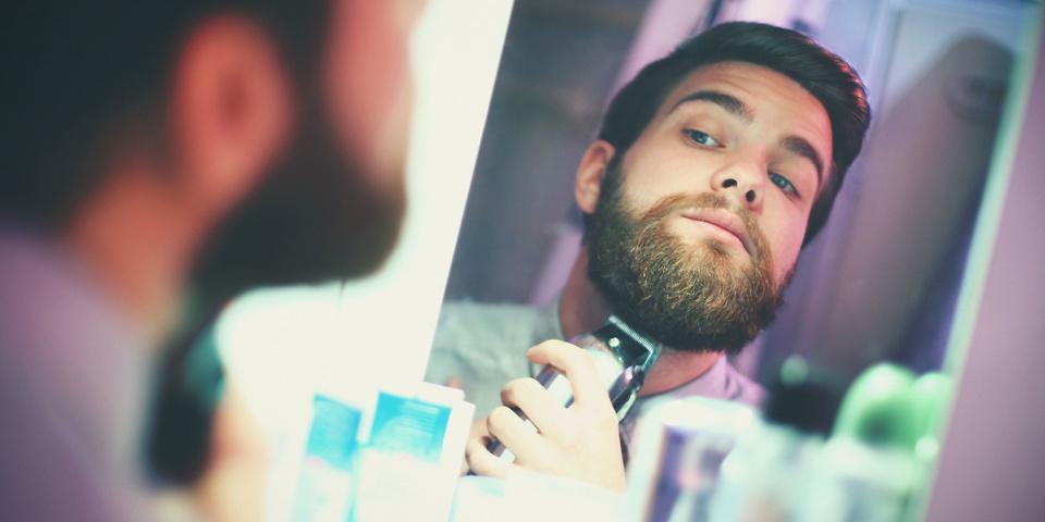 Man trimming beard