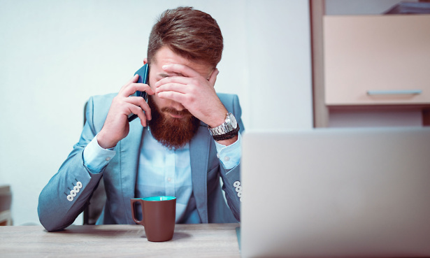 Man on phone making complaint