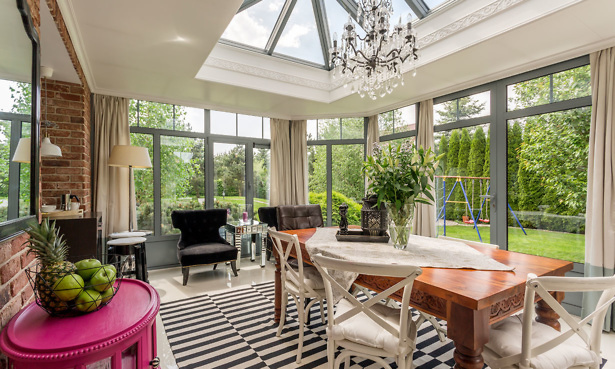 Modern conservatory interior with roof light and dining table and chairs
