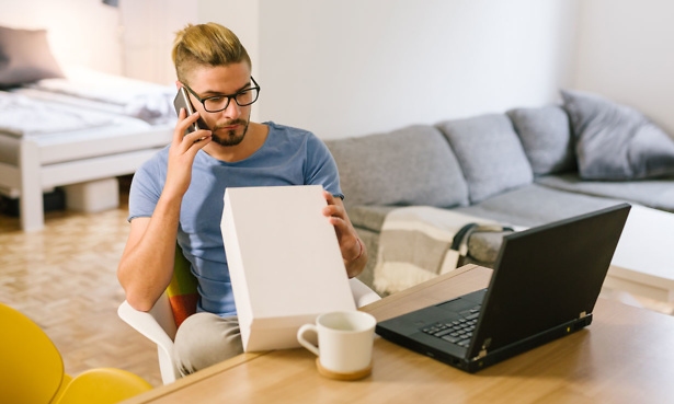 Man on phone complaining about online order