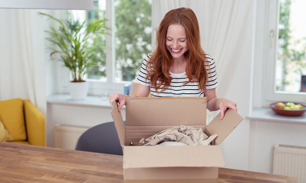 Woman happy opening parcel