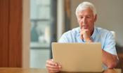 Senior man looking at laptop
