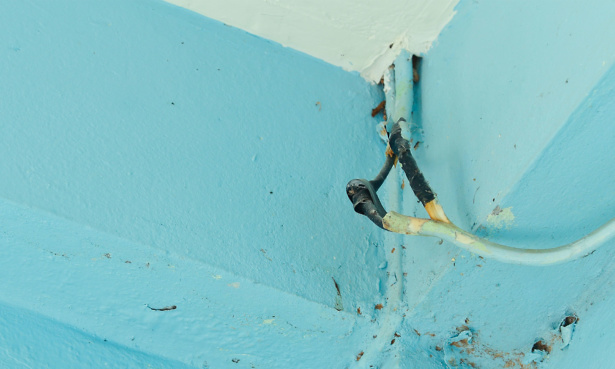Ceiling showing faulty wiring
