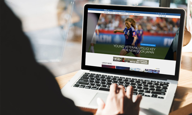 Browsing the homepage of FIFA on laptop