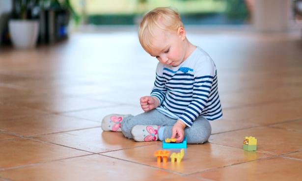 Child on floor with underfloor heating