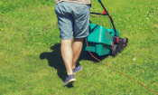Mowing a lawn with an electric lawn mower