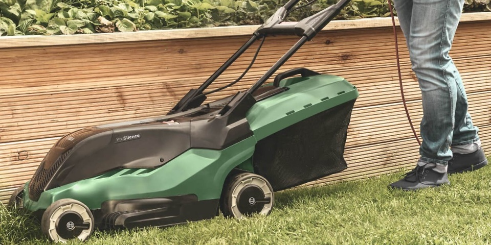 Cutting the lawn with a Bosch lawn mower