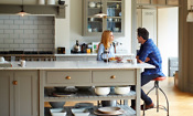 Couple talking in their kitchen