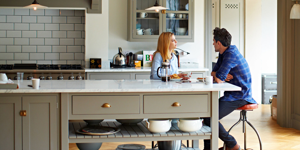 Couple talking in their kitchen