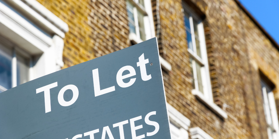 London, UK - April 8, 2017 - To Let property agency sign posted outside English terraced houses in Poplar, East London