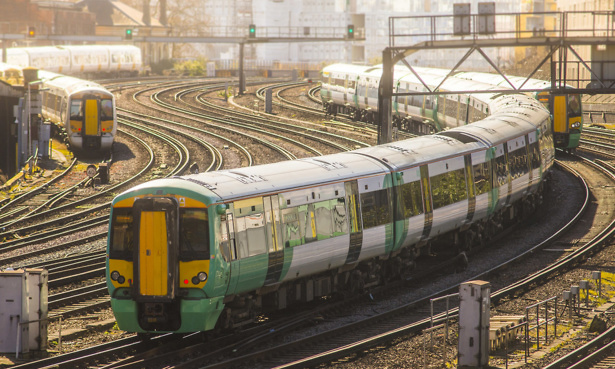 A London train arriving at a station (near Victoria station)