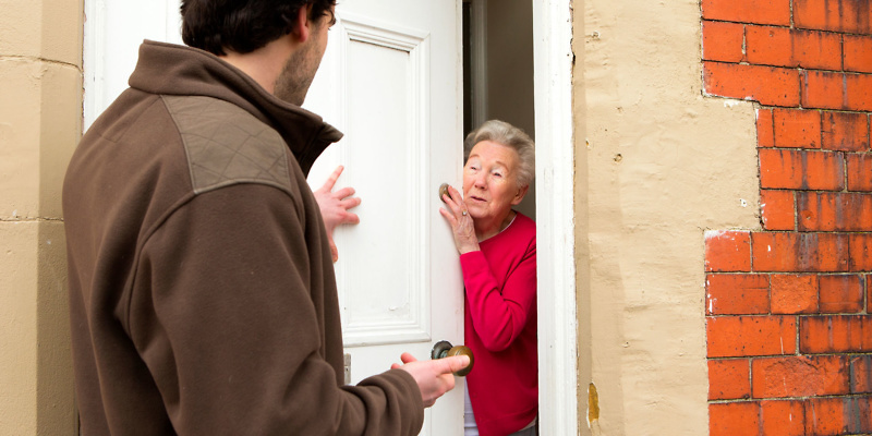 Trader cold-calling at an old lady's door