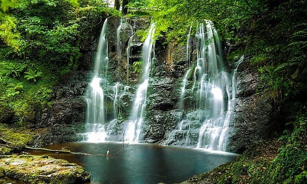 Beautiful waterfalls in a mossy woodland.