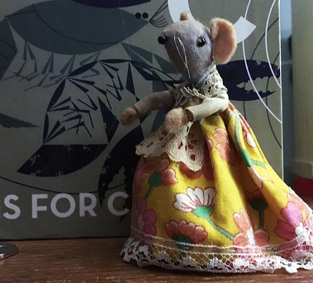 Mouse dressed in Victorian style dress