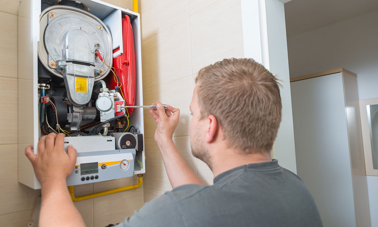 Engineer servicing a boiler