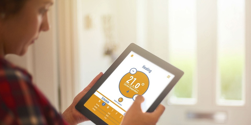 A woman monitoring her energy usage on a tablet