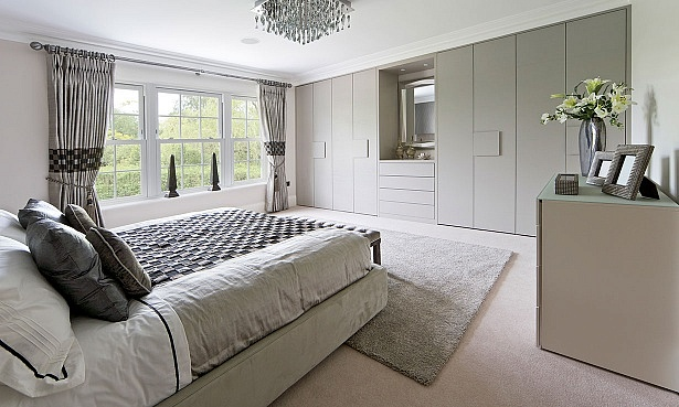 Fitted wardrobe in modern bedroom