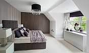 Fitted wardrobe in wood effect in modern bedroom