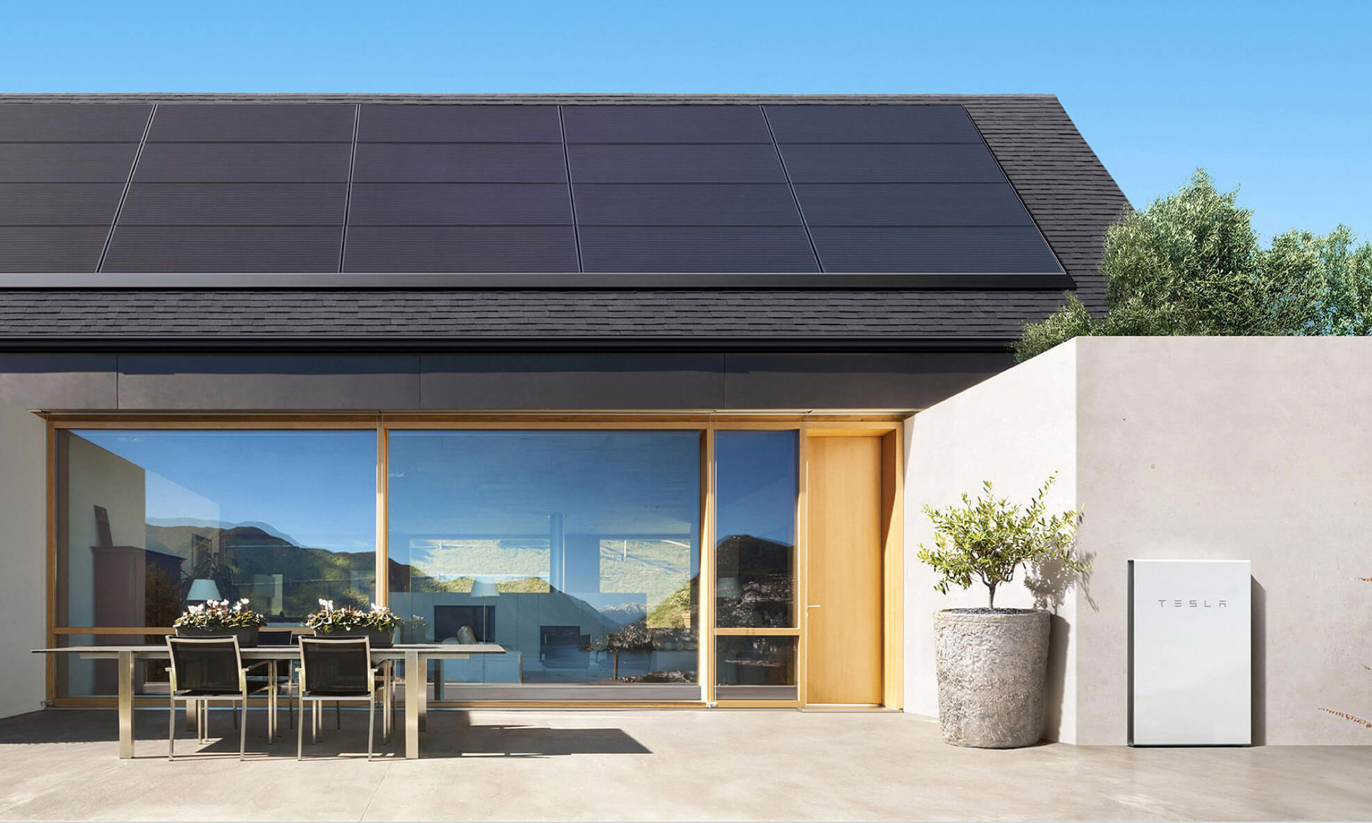 House with solar panels on the roof and a battery on the wall