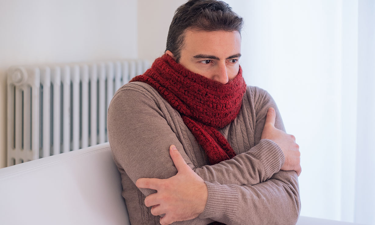 A man who is cold because his central heating isn't working