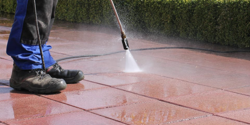 Pressure washing a patio