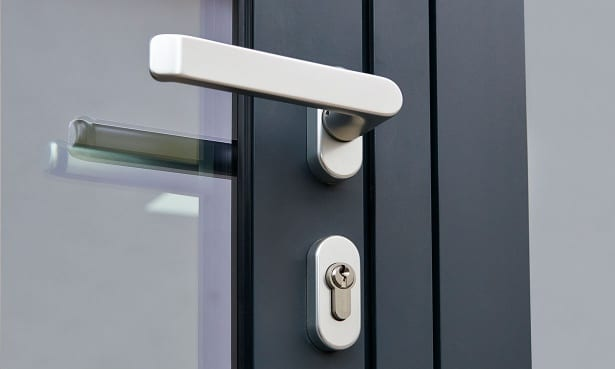Handle and lock on a double glazed door with a frame