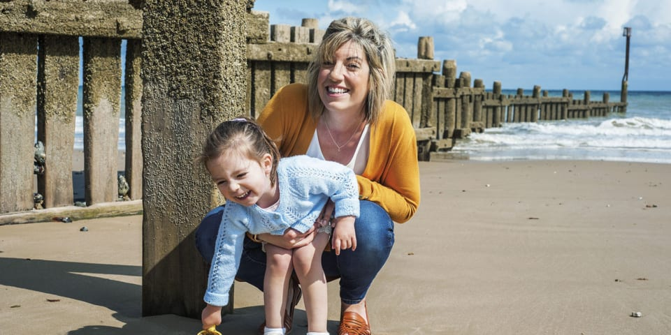 Abby and daughter Lottie, who found it impossible to get insured after Lottie caught a mystery illness.