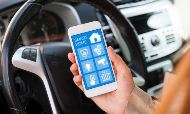 Smart home security app being used in a car