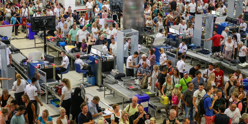 people queuing at airport security