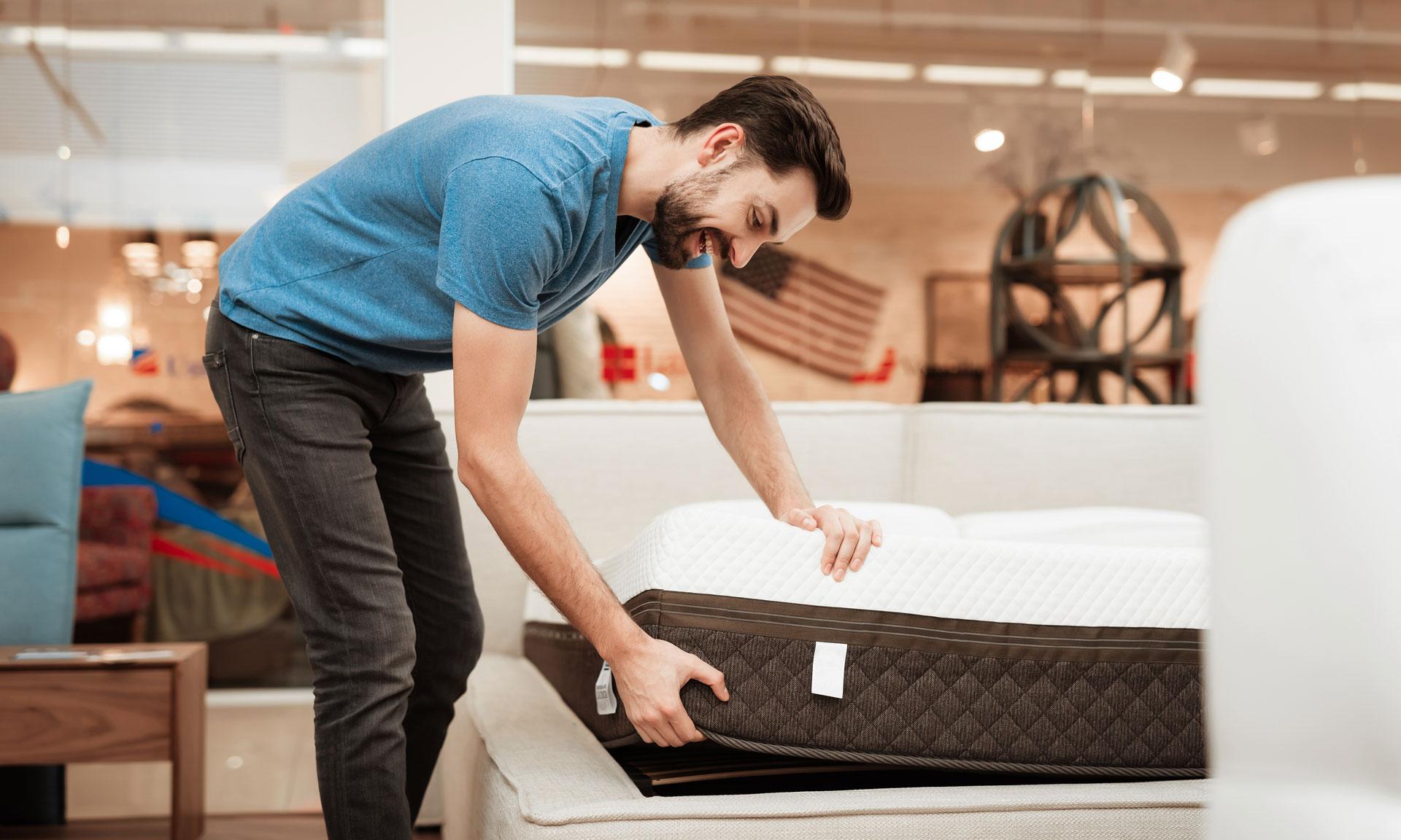Man choosing a mattress
