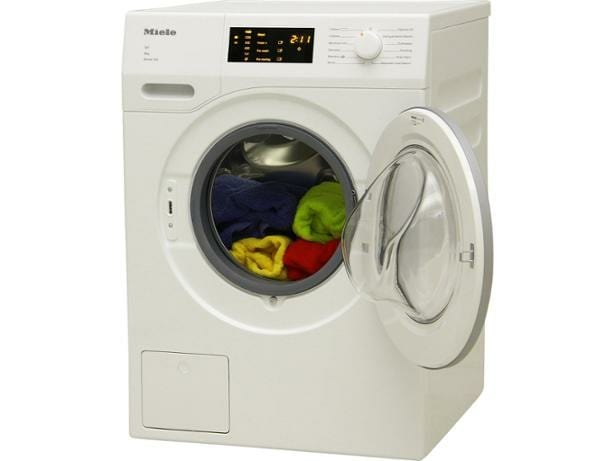 Miele WDD035 freestanding washing machine with clothes inside