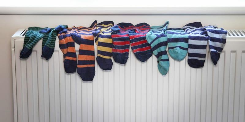 Stripey socks drying on a radiator