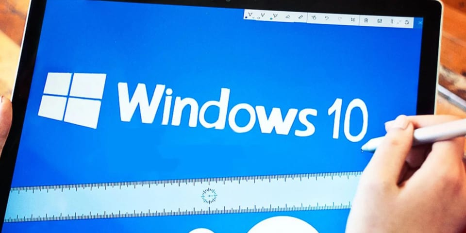 Windows 10 on the computer screen with white letters and a blue background