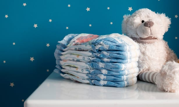 a pile of nappies next to a teddy