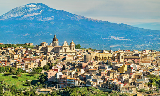 view of catania sicily with mount etna in the background