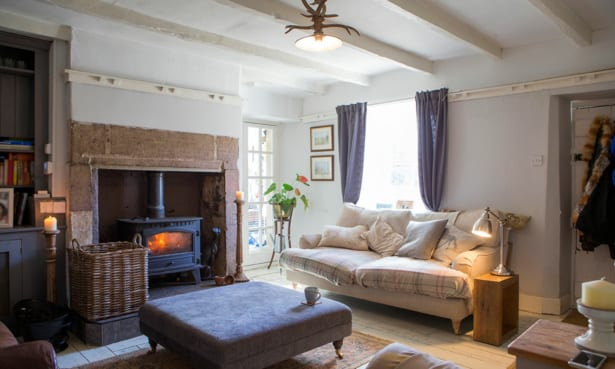 Large wood-burning stove in a country-style living room