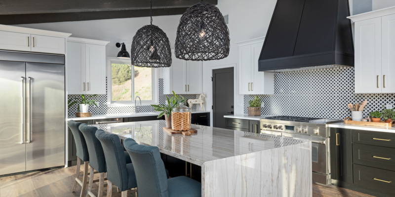 Black and white modern kitchen with kitchen island and seating