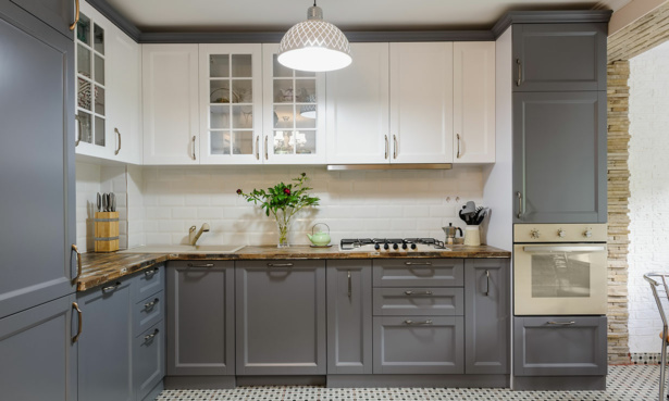 Grey and white shaker kitchen with mosaic floor