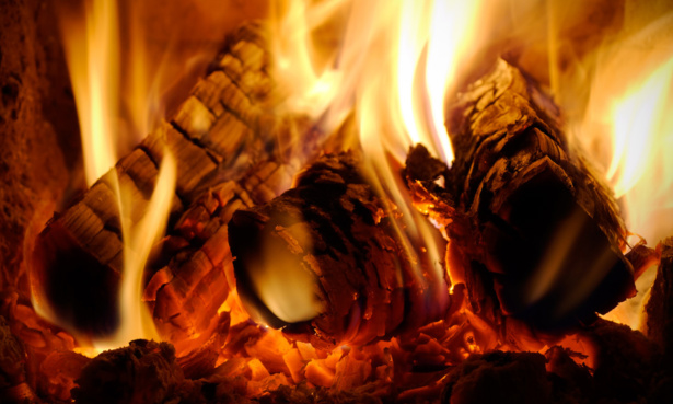 Logs burning fiercely in a wood-burning stove