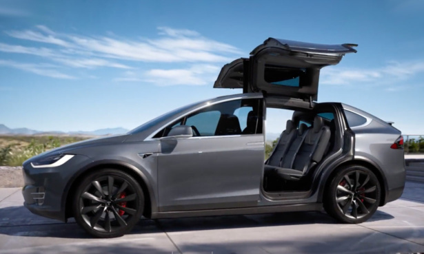 Tesla Model X with its falcon wings open