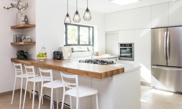 White modern kitchen with wooden breakfast bar