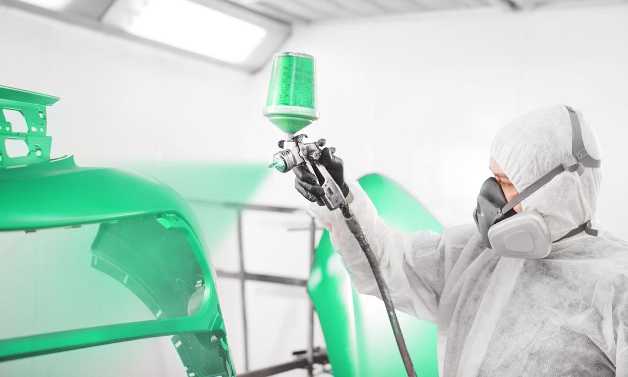 spraying a car green