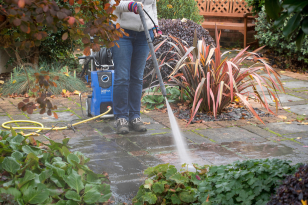 Cleaning a patio with a pressure washer