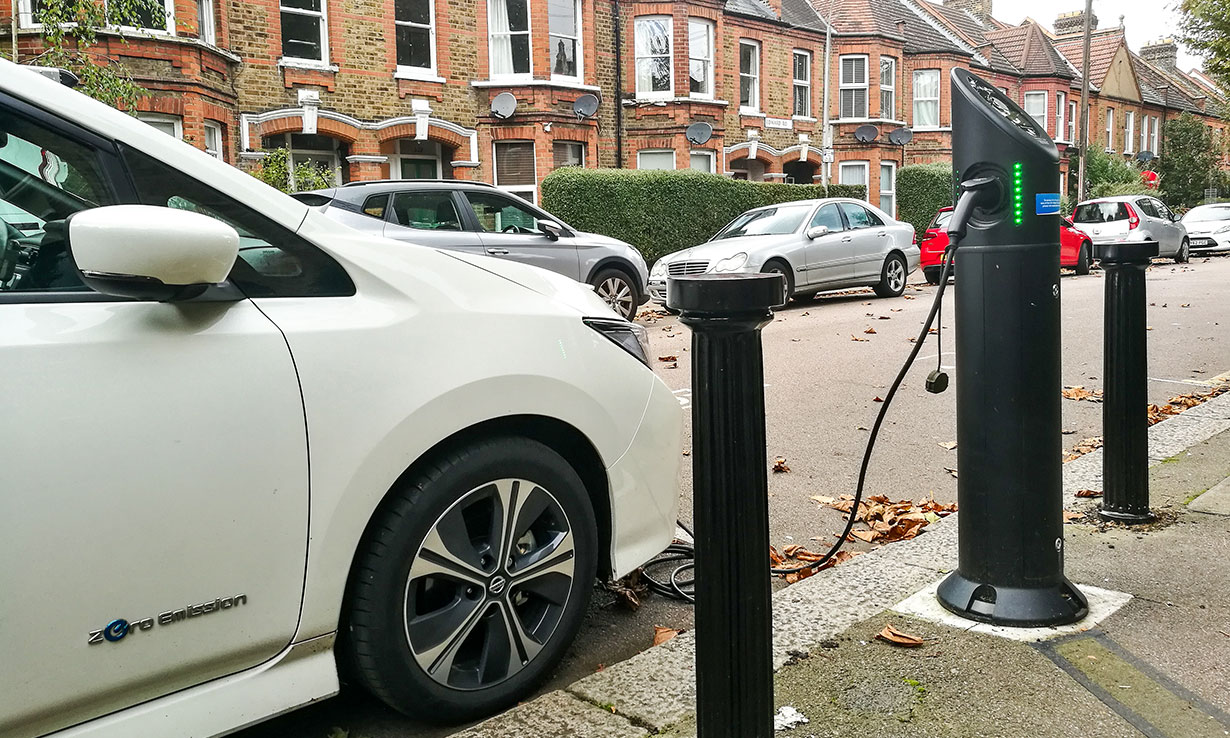 electric car charging at the side of the road