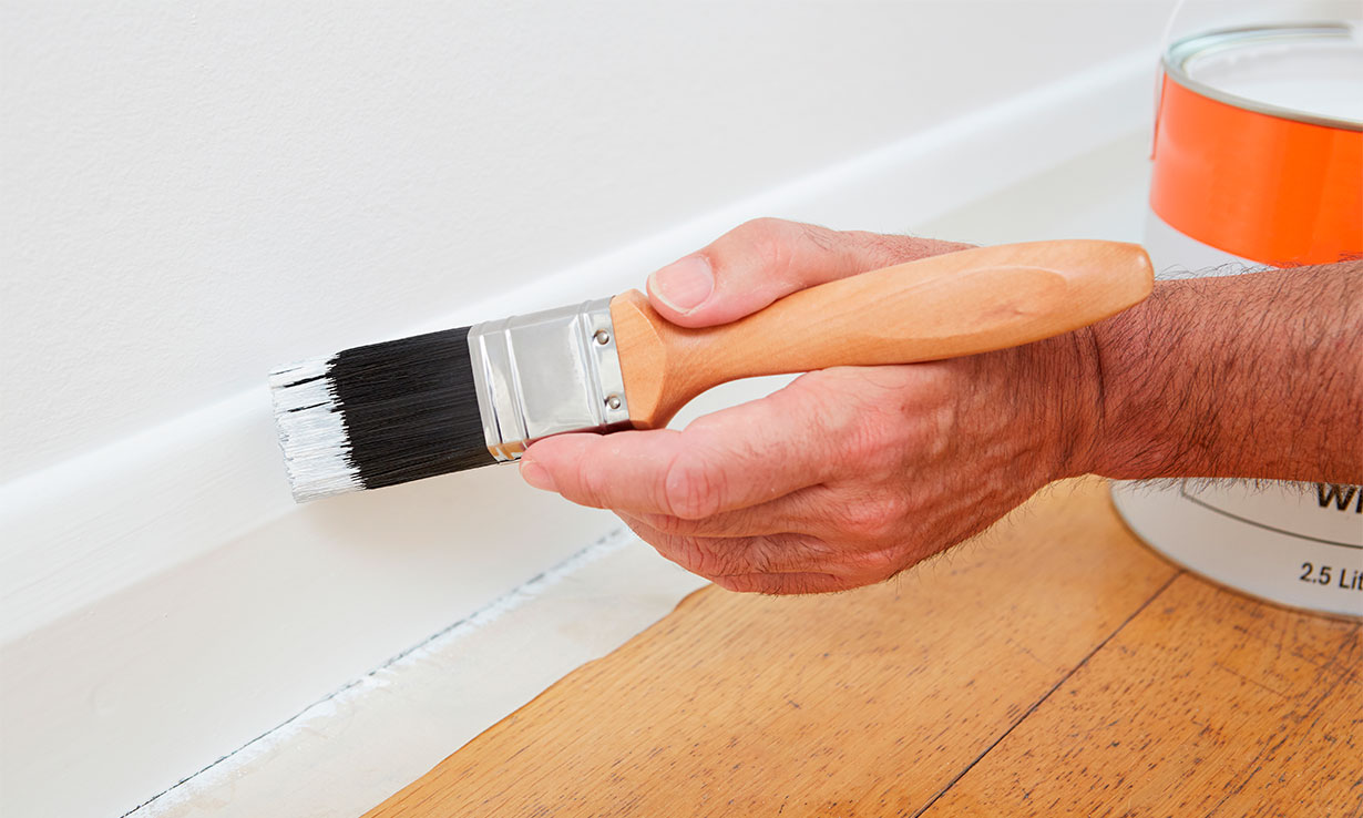 Painting a skirting board
