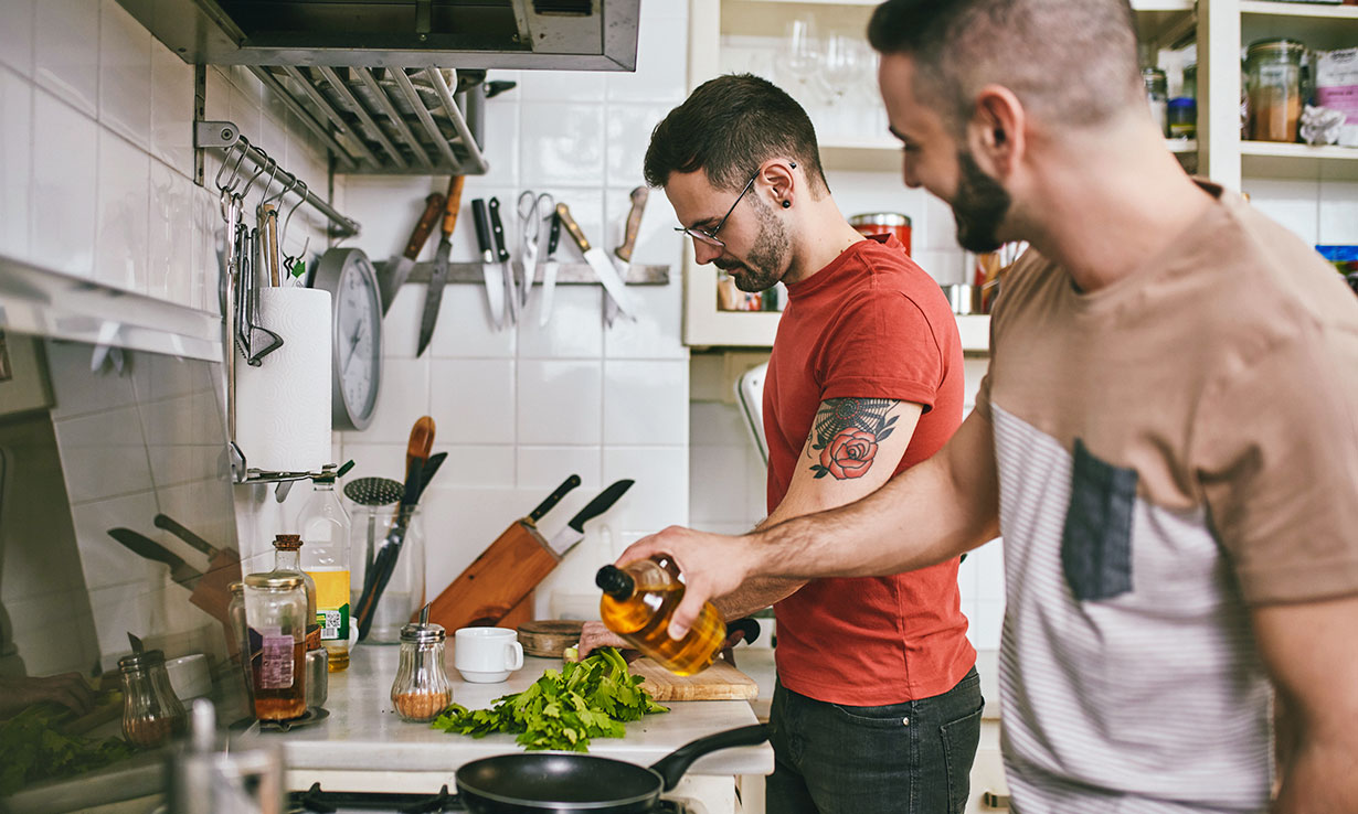 A couple cooking in a kitchen